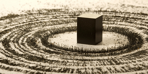 magnet and metal filings representing the Kaaba and pilgrims by artist Ahmed Mater