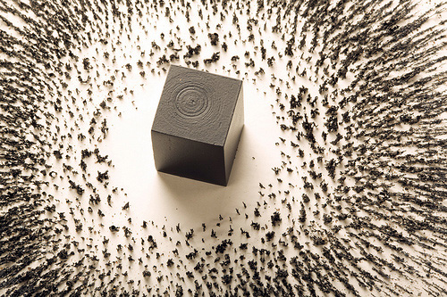 magnet and metal filings representing Kaaba by artist Ahmed Mater